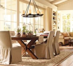 Robust Teak Dining Room Table Decor With Glass Vases Under Circle Chandelier Frame Design