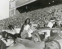 Clarice Davis, the first African-American Homecoming queen at Illinois, rounds Memorial Stadium in 1951.    Photo courtesy of the Chicago Defender