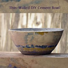 Large DIY cement bowl tinted with latex paint. Thin-walled so it isn't that heavy. Tutorial.