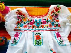 Adorable Mexican dress, Hand embroidered floral designs Exclusive from or Small Pieces of Embroidered Art for Girls  Mexican embroidered toddler dress perfect for any time of year - cool for the spring and summer months and cozy paired with a long-sleeved shirt/onesie and jeans, leggings or tights for the fall and winter months. Wear for a special occasion or any day of the week!  Stunning work intricately embroidered flowers in the front and back Available sizes 4-10 years Old  • Color…