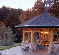 Rustic Columns & Poles Inside Log Homes .Some Are Real Trees! A fire pit gazebo with stone and tree accents around the columns.A fire pit gazebo with stone and tree accents around the columns. Backyard Gazebo, Fire Pit Backyard, Pergola Patio, Pergola Plans, Pergola Kits, Backyard Pavilion, Backyard Retreat, Cheap Pergola, Luxury Kitchens