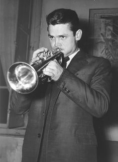 Chet Baker released from Jail. American jazz trumpeter Chet Baker sounds his trumpet in his Italian attorney's office at Lucca, west of Florence, after he was released from jail there Dec. 15, 1961. Chet Baker was sentenced to one year, 4 months and 5 days' imprisonment, in September 1960, for having illegally kept and having used drugs. (AP-Photo/Giulio Torrini) 15.10.1961 Ref #: PA.4809677 #jazz #trumpet