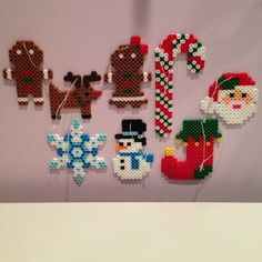 This is an 8-piece set of adorable handmade perler bead Christmas ornaments! Includes all your holiday favorites: gingerbread man and woman, Rudolph the