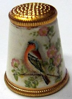 VINTAGE AUSTRIAN THIMBLE - GOLD-TONED WITH BIRD.