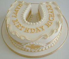A pretty horse shoe cake.
