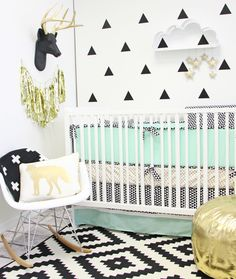 A modern mint nursery combining my favorite things, black and white, bold patterns, tissue tassels, clouds, Caden Lane Bedding and the colors mint and gold.