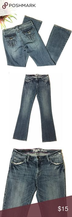 "Rock 47 Fleur De Lis Rhinestone Boot Cut Jeans Wrangler Rock 47 Fleur De Lis Rhinestone Flap Pocket Low Rise Boot Cut Denim Jeans SZ 7 8  *Jeans show signs of wear and wash. Please see pictures.  Measurements: 30"" Waist 32.5"" Inseam 8"" Rise Wrangler Jeans Boot Cut"