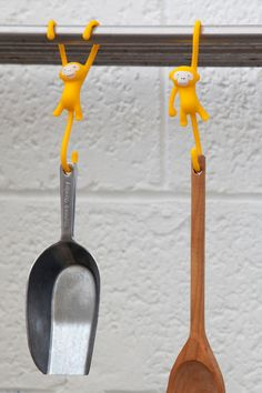 Organize your kitchen utensils with a smile. A great solution for hanging your tools in the kitchen, adding a touch of humor to the kitchen interior.