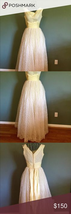 "Custom VINTAGE 1950's Formal Gown This is a custom made formal lace dress. It is quite possibly the most beautiful dress in the world, and in immaculate condition. It's a perfect soft yellow. It has a metal zipper back closure and two hook and eye clasps. Perfect for any formal occasion or even to wear as a wedding gown.   Please read measurements carefully to ensure a proper fit.   Bust - 33-34"" Waist - 24-26"" Hips - free Length - 56-57"", shoulder to hem Vintage Dresses"