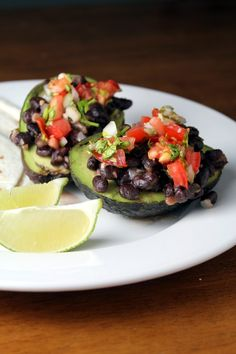 Black Bean Stuffed Avocados (A healthier way to eat Mexican Food without the Guilt)  4 ripe avocados  one batch of spicy beans  one batch of pico de gallo  queso fresco  tortillas    spicy beans-  15 ounce can black beans, rinsed  2 tablespoons butter  1/2 onion, diced  3 gloves of garlic, minced  3/4 cups water  1/2 teaspoon dried oregano  salt & pepper