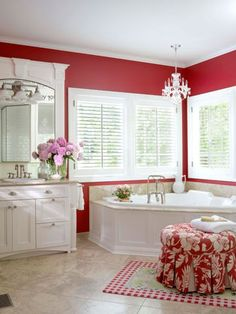 This looks like my tub ~ I only have the one big window ~ Tile is similar ~ Loving this idea of the red walls. Now where do I get the trim for the mirror ~ Still time to change it.