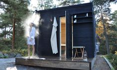sauna in the yard with black woods exterior along with fantastic shower outside and simply shelving also small stool Saunas, Outdoor Sauna, Outdoor Baths, Outdoor Showers, Mini Sauna, Sauna A Vapor, Sauna Shower, Sauna House, Sauna Steam Room