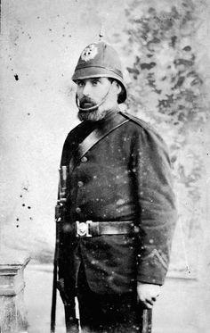 A studio portrait of a policeman.