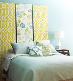 Choose two wallpaper patterns to create a personalized do-it-yourself headboard for your bed. Hang one strong wallpaper for the center panel and select a subtler pattern for the flanking panels. Here, a green-and-white pattern is the perfect complement to a striking floral green, white, and blue design.