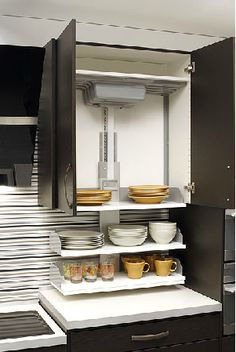 The Verti Shelving Lift System Is A Great Way To Make Upper Cabinets Accessible For People