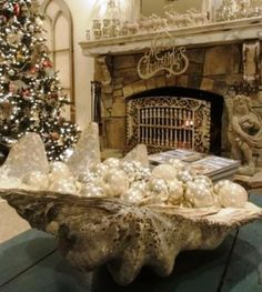 "A huge shell filled with ""pearly"" globes!!! Great for a Coastal New England Christmas!!! Love this!!! Bebe'!!!"