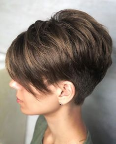 Pixie Haircuts with Bangs - 50 Terrific Tapers Voluminous Undercut Pixie Hairstyle Another edgy option, this pixie haircut with bangs owes a lot of its chic to the undercut section. You can also try it in a tapered shape if you want a smoother look. Undercut Pixie Haircut, Choppy Bob Hairstyles, Haircut For Thick Hair, Short Pixie Haircuts, Haircuts With Bangs, Cool Hairstyles, Beautiful Hairstyles, Nape Undercut, Hairstyles Pictures