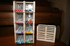 Glue together a couple wooden IKEA utensil holders. Quick, easy, & inexpensive!