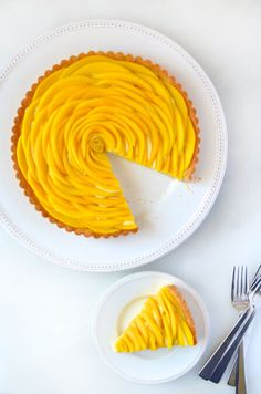 Add a pop of flavor and color to your dessert spread with the ultimate mango tart filled with vanilla pastry cream.