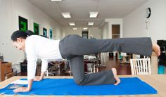 yoga pants girl stretches in office