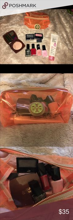 """Tory Burch cosmetic bag full of products! Tory Burch bag has a few scuff marks on it. Products are- AVON glow bronzer shade """"warm glow"""" (never used), 4 AVON nail polishes (black fringe and red are brand new), AVON Skin So Soft hand cream (has barely been used), 2 Maybelline eyeshades in shades """"smoky coal"""" and """"pink wink"""" (both have been used maybe twice), and a brand new Maybelline eyeshadow primer. Tory Burch Makeup"""