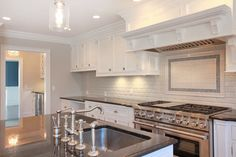 white kitchen by SHD