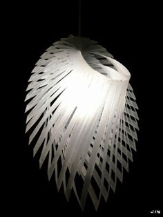 This site shows a large selection of light fixtures made from paper.