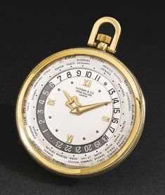 PATEK PHILIPPE: AN IMPORTANT AND RARE 18K YELLOW GOLD OPEN-FACED WORLD TIME WATCH, RETAILED BY TIFFANY & CO. 1951 REF 605 HEURES UNIVERSELLES MVT 931076 CASE 683460