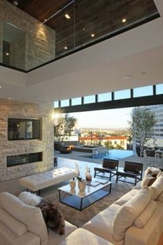 indoor/outdoor living space-really cool! Love the furniture and the airy feel and look, but would have to add some brightly colored throw pillows and art!