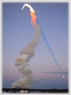 Amazing rocket plume shadow and full moon rising.
