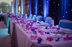 Weddbook is a content discovery engine mostly specialized on wedding concept. You can collect images, videos or articles you discovered  organize them, add your own ideas to your collections and share with other people - Weddbook ♥ Pink/Blue Orchids on wedding tables.