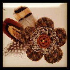 Homemade tweed, feather and button wedding invitation decoration. www.littlegreenowl.co.uk