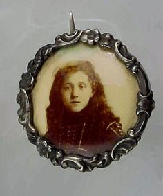 A haunting face in an Art Nouveau photo locket/pin.