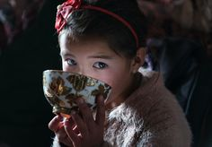 6 Year-old Eagle huntress relaxing tea times in Mongolia.