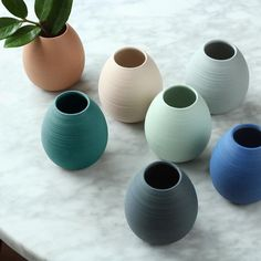 Ribbed Bud Vase — Pigeon Toe Ceramics A gently tapered, tinted porcelain bud vase with hand carved lines that add texture to the unglazed porcelain exterior. Ceramic Mugs, Porcelain Ceramics, Fine Porcelain, Painted Porcelain, Porcelain Tiles, Ceramic Bowls, Porcelain Skin, Porcelain Doll, Stoneware