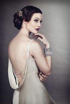 Gatsby-inspired makeup and hairstyle: A sexy, jewelled criss-cross strap back calls for elegant upswept hair like Ellen's tousled chignon. Her shoulder-length hair was curled, then pulled into a loose bunch at the nape of the neck and finished with a vintage brooch.