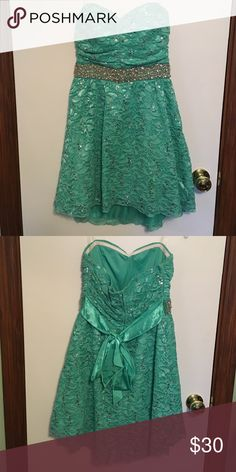 Beautiful Mint Green Dress Strapless mint dress dress. Shines with beading and sequins. Worn to homecoming but can be worn for any special occasion! mymichelle Dresses Strapless