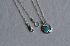Silver pendent with green chrysoprase bezel and by pliersAfires