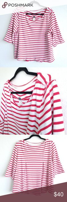 """Free People We the Free Cannes Ribbed Tee Stripe Free People We the Free Cannes tee with red and white stripes. Ribbed textured material. High low hem. Size large. Oversized fit. No flaws.  OB563994  -bateau neckline -a-line cut -95% cotton & 5% spandex -waffled pattern  Chest pit to pit 21.5"""" Sleeve length 14.5"""" Front length from shoulder approx 22.25"""" Back length from shoulder approx 24.5""""  