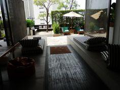 Sun lounges around The Beach area - poolside at the Millennium Hilton, Bangkok