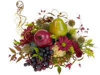 Contemporary Thanksgiving Cornucopia Centerpiece.  Fruit and flowers combined with decorative wire makes a perfect arrangement.  Easy to follow slide show demonstration