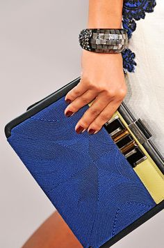 the detail on this clutch - fabulous . gotta love the Oscar .  Oscar de la Renta Spring 2012