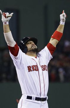 Boston Red Sox right fielder Shane Victorino celebrates after hitting a three run RBI double during the third inning of Game 6 of baseball's World Series.