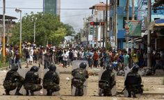 This photo shows police officers clashing against protesters. Peru has been having a lot of riots as of late. From miners, to the indigenous population.