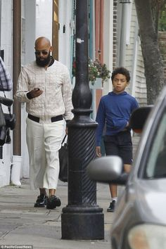 Man of the hour: Solange's husband-to-be, Alan Ferguson, and her 10-year-old son from a pr...
