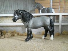 This is a repainted Dartmoor Pony mare, her original color was Dark Bay with blaze upon her muzzle. Now, this mare is repainted to the color of Light Gray, Black, and White. This is Clover, the first addition to the Schleich Ranch.
