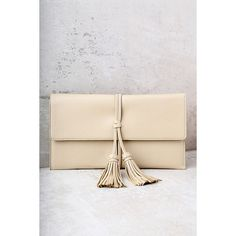 Indra Beige Tassel Clutch ($25) ❤ liked on Polyvore featuring bags, handbags, clutches, beige, vegan leather purses, pink handbags, faux leather handbags, beige clutches and tassel handbags