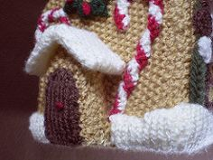 This is the first in a series of 24 linked patterns, published daily in December 2014, to decorate a knitted Gingerbread House. The pattern for the house itself is published separately.