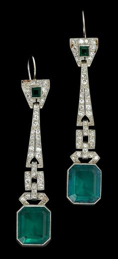 Emerald and diamond drop earrings art deco Classic platinum drop diamond set pendant earring with single emerald displayed within, finishing in a large step cut synthetic emerald.