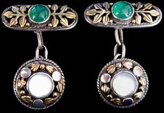 This is not contemporary - image from a gallery of vintage and/or antique objects. ARTIFICERS' GUILD (1901-1942)  A pair of silver and gold cufflinks set with pearl and chalcedony.